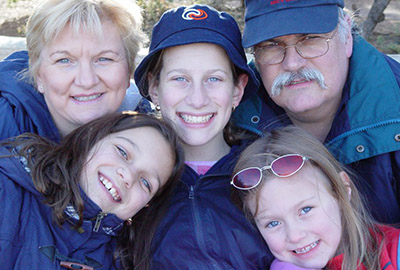 family faces of five tourist poising for photo