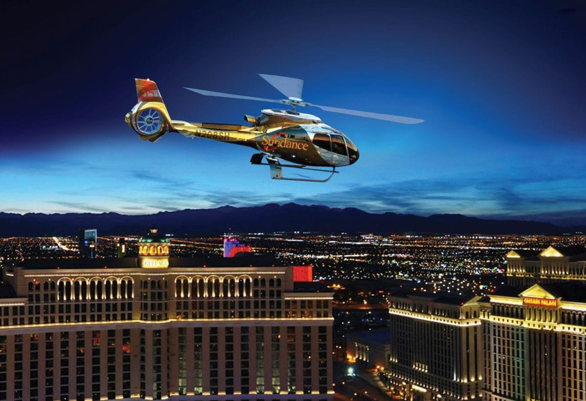 Sundance Helicopter Soaring Over the Las Vegas Strip at Night