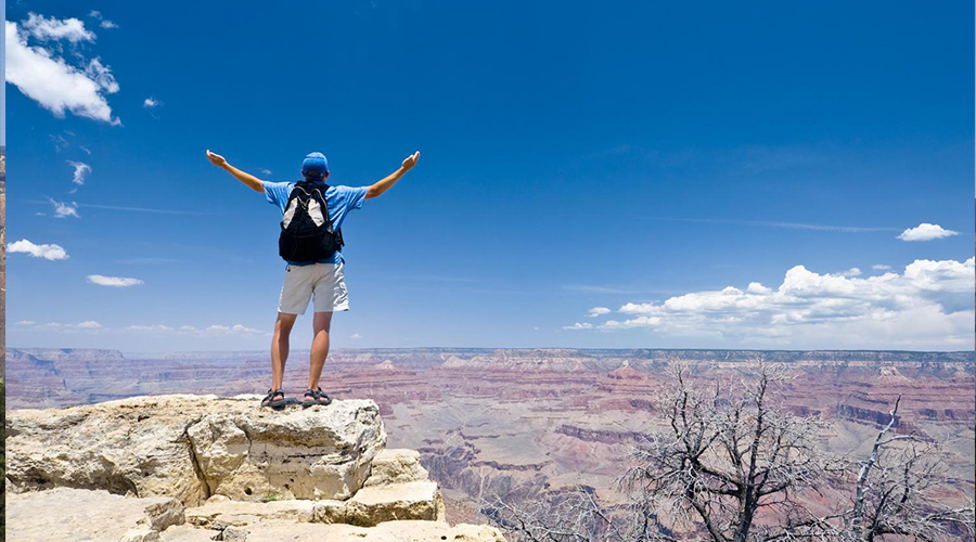 Grand Canyon South Rim Hiker with Arms Wide Open 900 x 500