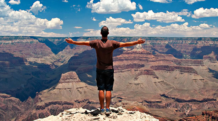Grand Canyon West Rim Arms Out In Awe 900 x 500