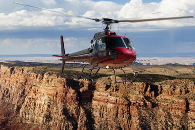 Helicopter Soaring Over Grand Canyon South Rim