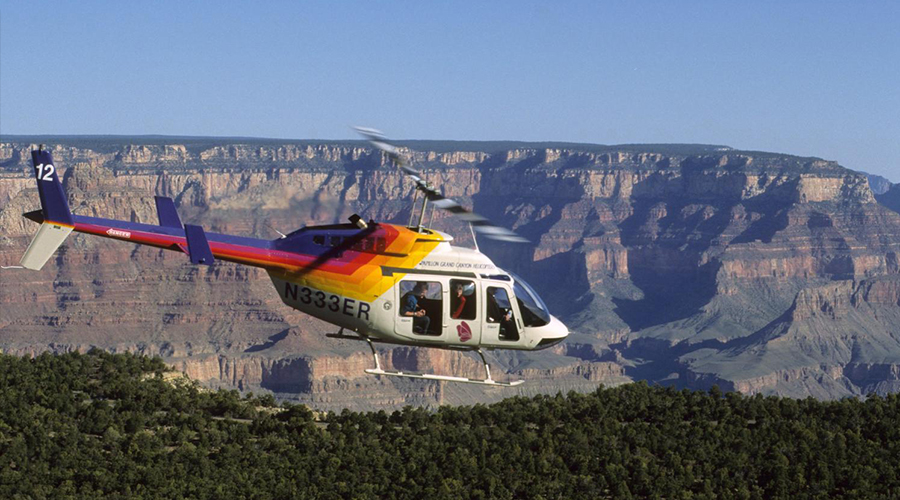 Helicopter Soaring Over The Grand Canyon South Rim