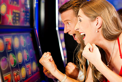 Tourist Playing Slot Machine in Laughlin