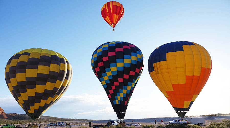 4 Hot Air Balloons lifting off
