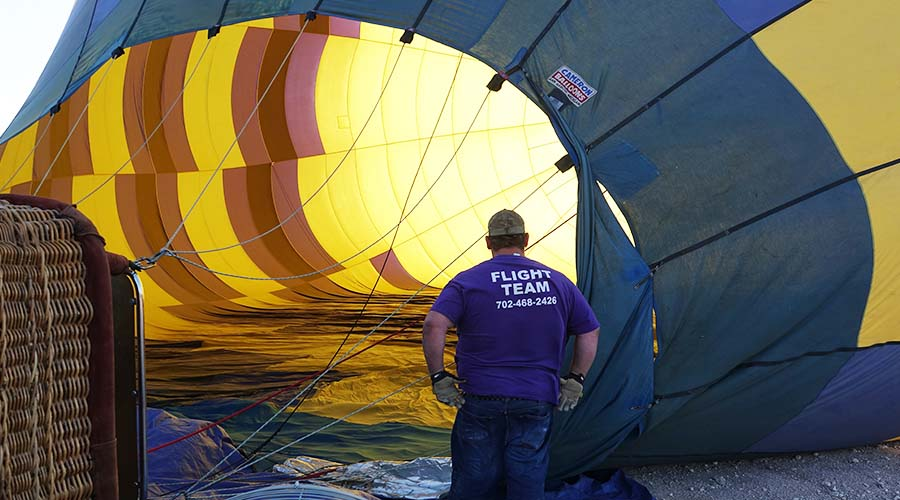 Flight Team Member Filling Hot Air Balloon