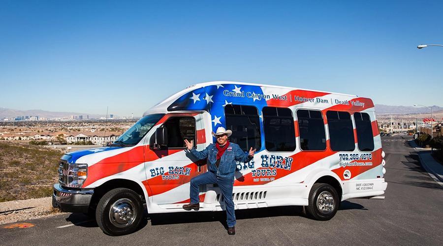 Bill posing with Big Horn 14 passenger tour van