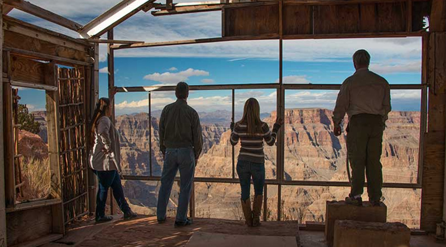 Guest in old building looking out over Grand Canyon West Rim