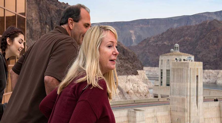Guest peering over Hoover Dam