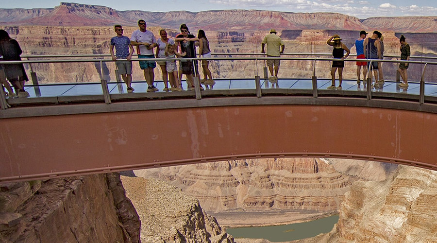 Guest standing on the Grand Canyon West Rim Skywalk