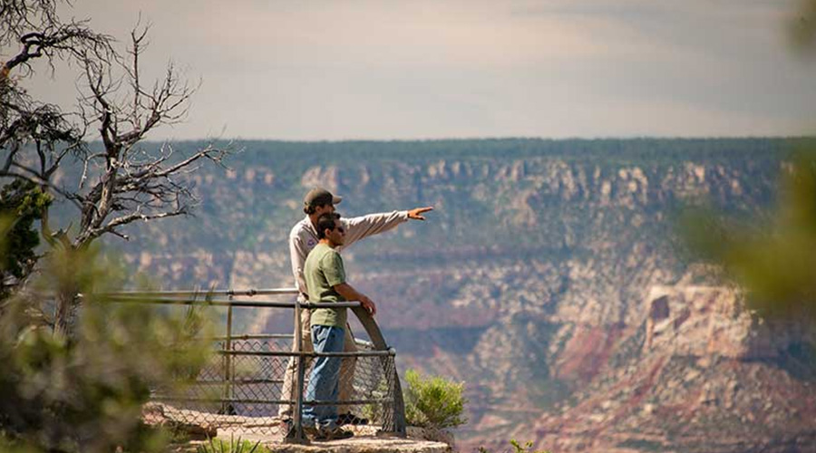 Guide and Guest at Grand Canyon South Rim at Mather Point 2