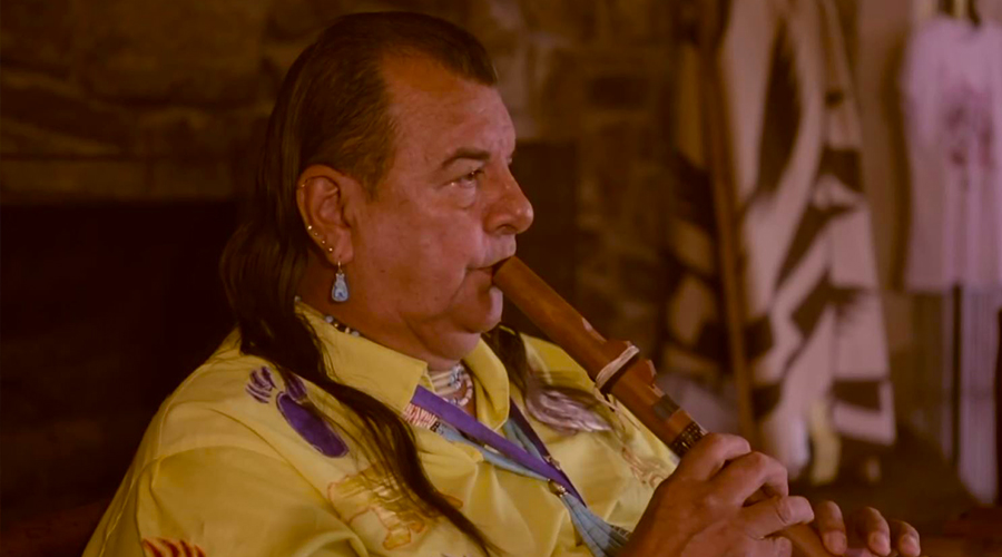 Hualapai Indian playing a flute