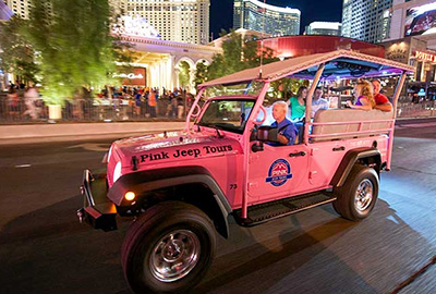 Open Air Pink Jeep With Guest on Las Vegas Strip