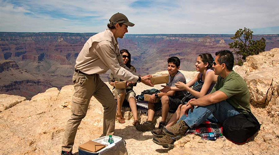 Pink Jeep Guide Serving Lunch to Guest at Grand Canyon South Rim Coconino Plateau