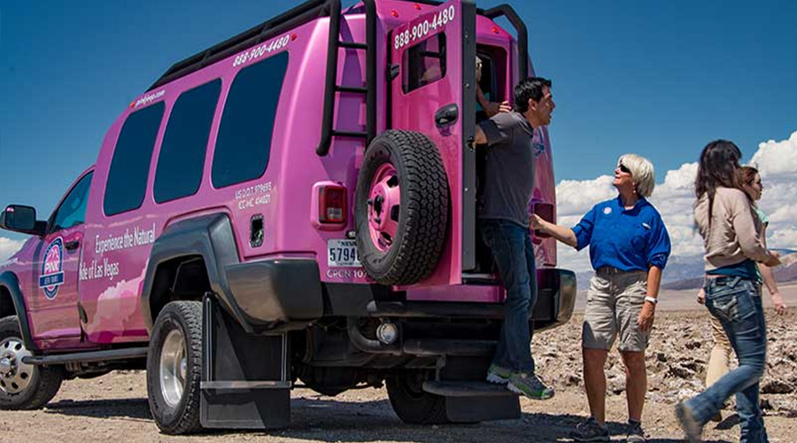 Pink Jeep Trekker unloading guest at Death Valley