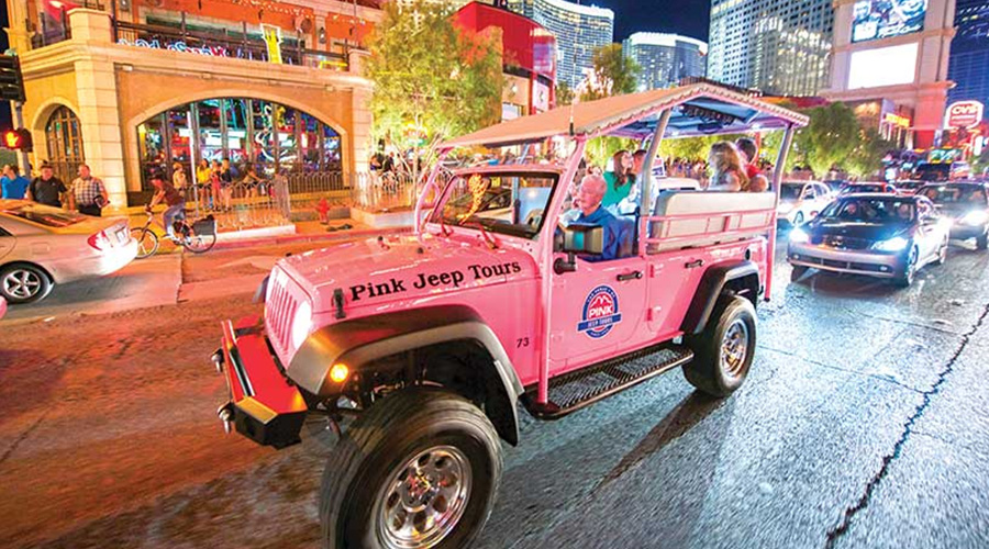 Pink Jeep with guest on Las Vegas Strip at Night