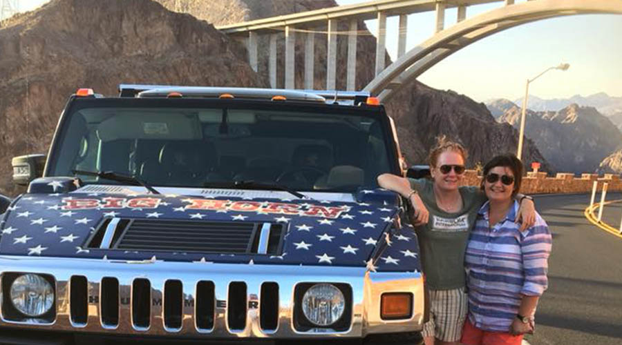 Couple posing at Hoover Dam with Big Horn Hummer