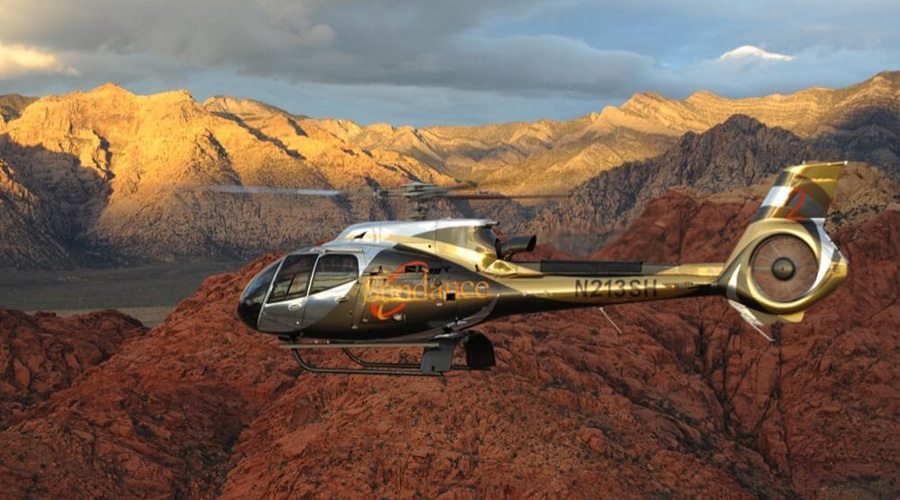 Sundance Helicopter Soaring Over Red Rock Canyon