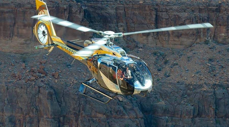 Sundance Helicopter Soaring Past Grand Canyon Cliffs