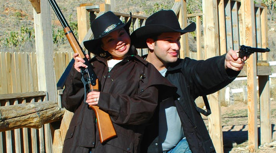 Cowgirl and Cowboy with Guns